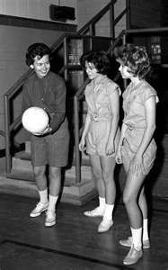 Gym uniforms. Mine: black shorts and white heavy cotton blouses. We embroidered our name above the breast pocket. Washed and crisply ironed for monday inspection.
