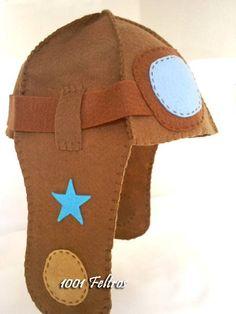 Chapéu+feito+em+feltro+modelo+capacete+de+aviador.+Poder+ser+personalizado+em+suas+cores+e+apliques.+Totalmente+costurado+a+mão R$ 40,00