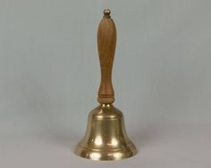 Vintage Solid Brass Bell Wooden handle School bell Dinner bell Brass Clapper Hand bell 8 1/2 inches tall Very heavy brass tip on handle by eyespytreasure on Etsy