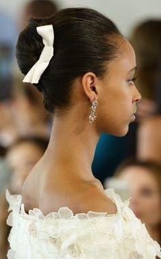 Sleek french twists with pretty bows at the Oscar de la Renta Bridal Spring 2016 show // Wedding Hair and Makeup Ideas From Bridal Fashion Week