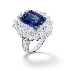 De Grisogono ~ Fifty-four briolette-cut white diamonds artfully clustered around a spectacular 11.67ct cushion-cut blue sapphire from Sri Lanka. #deGRISOGONO #HighJewellery #Craftsmanship