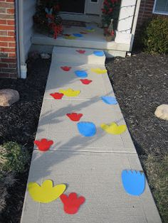 Elmo, Big Bird and Cookie Monster footprints up to the house for Elmo & Sesame Street Themed Birthday