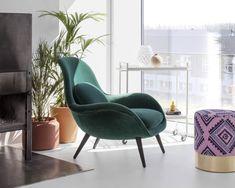 Swoon lounge chair dressed in luxurious velvet designed by Raf Simons