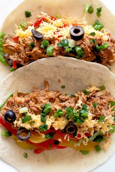 Slow Cooker Mexican Pulled Pork Tacos Recipe - this crock pot pulled pork recipe has outrageous flavor and is easily one of my most requested recipes! Always a hit!
