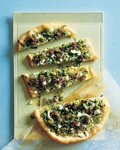 Flatbread Topped with Mint, Feta, and Lamb | Drawing on mint's eastern Mediterranean roots, this appetizer softens the sharpness of mint, lamb, and feta with gently cooked leeks and scallions. Drastically speed up this recipe by substituting store-bought pre-baked flatbread (Trader Joe's has good ones) for the homemade in this recipe.)