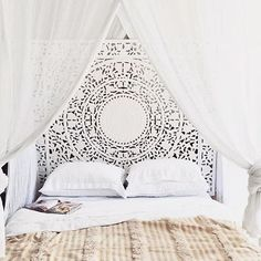 Bed with Moroccan wedding blanket.