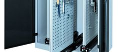 Storage cabinet / with sliding panels / vertical / for tools - LISTA