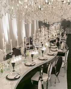 Chandeliers and candelabras lined the serpentine dining table.... #EdgarandCelio 's Rehearsal Dinner... Hosted in the @RevelryEventDesign Studio Black & White with millions of chandeliers! The design featured our new Serpentine Tables with Washington Chrome Chairs. #edgarandcelio #lovewins #grateful Creative Team: @katiebeverleyphoto @revelryeventdesign @celiosdesign @images_lighting @allureeventsatelier @ClassicParty @ImpressiveCreations #TeamRevelry Media Partner Grace Ormondes…