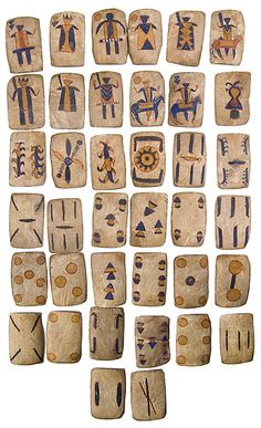 Apache Painted Rawhide Playing Cards Set of 37; all painted in red, yellow, and blue; 3.5 in. x 2.25 in.; 19th century.  Historical society states that these cards were accessioned in 1908 and were used for the game of Monte.