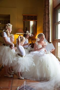Watching the bride open her gift.  Welsch Photography.