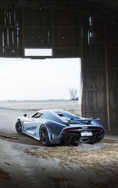 Koenigsegg Regera, hiding in a barn, waiting to fire up its engines