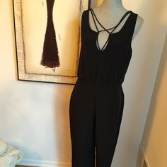Zara Black Crossed Strap Jumpsuit Size Med Gorgeous black long  jumpsuit size medium. Flowing trousers. 100% polyester. Deep V in the back 14 inches down the back. Crossed straps at the back and on the front also on the chest. Zara Other