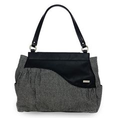 Neisha    Classic houndstooth fabric in miniature pattern is flecked with the tiniest hints of silver giving it a sparkle.  Offset by a black wave of faux leather across the top  Available from www.mycdsite.com.au/amandar