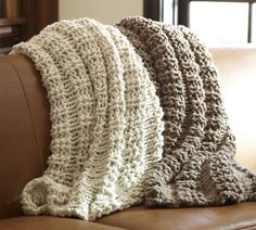 chunky sweater throws. - pottery barn  ~Obviously, the ones pictured here are not handmade, but could take several sweaters and join then together with a simple crochet stitch.  Lovely!