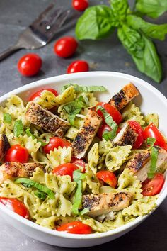 This Pesto Pasta Salad with Grilled Chicken is an easy and delicious weeknight meal.  Serve it cold as a summer pasta salad or hot as a delicious winter entree!