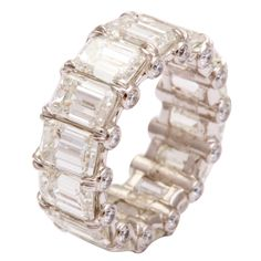 Impressive Emerald Cut Diamond Wedding Band | From a unique collection of vintage band rings at http://www.1stdibs.com/jewelry/rings/band-rings/
