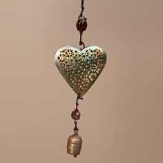 Give your home a fun decor accent with this heart hanging art. This delicate mobile is crafted with recycled iron, glass beads and NANA bells.