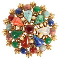 1950s brass brooch with 29 natural stones and crystals.  Product: BroochConstruction Material: Brass, stone and ...