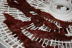 How to make beef or venison jerky at home using an oven or food dehydrator Best Beef Jerky, Venison Jerky, Beef Jerky Dehydrator, Dehydrator Recipes, Jerkey Recipes, Snack Recipes, Cooking Recipes, Frugal Recipes, Making Jerky