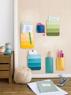 Paint Swatch Pockets How cool! 25 Craft Room Organization Tips