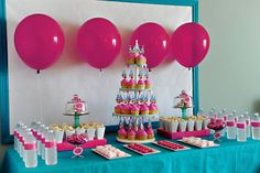 Elle Belle Creative: One Year Old in a Flash - The Dessert Table in pink and teal.  Chocolate covered Oreos, cupcakes, popcorn in custom mini popcorn boxes, water bottle lables, macaroons, chocolate bliss, and homemade marshmallows!  www.ellebellecreative.com