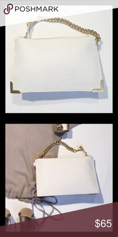 """Foley + Corrina Leather Wristlet Simple textured leather and gold detail make this wristlet elegant and timeless. The heavy duty curb chain can be attached to the zipper pull or looped on the side. Inside pocket. 6""""H x 10""""W x 1 1/2"""" D. 10"""" drop. Foley + Corinna Bags Clutches & Wristlets"""