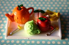 (Fruity tea set with the lids on, by lili_mini via Flickr.)