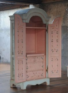 Armoire. Different colors, but love that the doors can be left open & it's still pretty