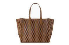 (Almost) Too Good to Be True Gym Bags | This minimalist Zara Large Perforated Shopper Bag ($80) is sans bells and whistles so it's light and easy to carry.