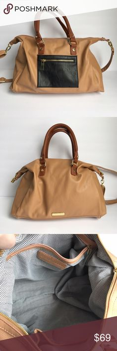 • Steve Madden • camel colored handbag Tan, brown, and black leather purse. Has both handles and also a detachable crossbody strap. White and black chevron patterned lining. Pockets on inside and outside. Elegant satchel for your wardrobe! Steve Madden Bags Satchels