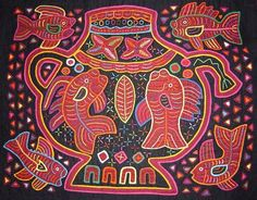 Mola- San Blas.  I was lucky enough to live in Panama - and have 3 wonderful examples of this beautiful cut applique work.