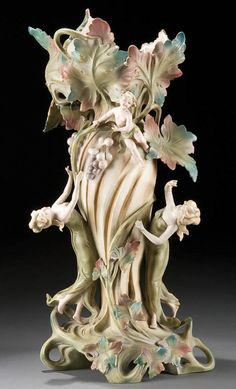 ART NOUVEAU FIGURAL PORCELAIN VASE late 19th Century by Fraureuth Porcelain comprising a reticulated scrolling flora form Flanked by figural nymphs and a putto.