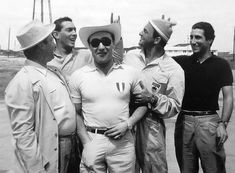 Ferrari team drivers Juan Fangio, Luigi Musso, Eugenio Castellotti, Harry Schell and Alfonso de Portago. Only Fangio would survive to an old age, dying at 84 in 1995. The other four would all die young in racing accidents by 1960