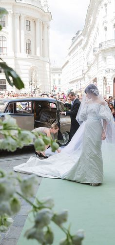 Caroline Sieber arriving for her wedding to Baron Fritz von Westenholz at Michaelskirche, one of Vienna's oldest churches.