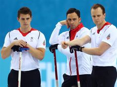 David Murdoch (C), Scott Andrews (L), and Michael Goodfellow (R) of Great Britain look on during the men's semifinal match between Sweden and Great Britain at Ice Cube Curling Center. Sochi 2014 Day 13 - Curling Men's Semifinal.