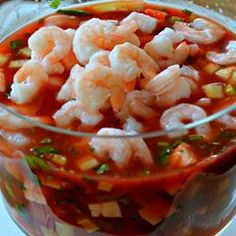 Original Mexican Shrimp Cocktail Recipe - Shrimp with tomatoes, avocados, sweet onion, and cilantro bask in a zesty tomato salsa for an appetizer that looks beautiful when served in a glass salad bowl. Serve with saltine crackers. Shrimp Ceviche, Ceviche Recipe, Shrimp Soup, Spicy Shrimp, Shrimp Recipes, Fish Recipes, Mexican Food Recipes, Sashimi, Mexican Shrimp Cocktail