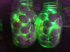 All you need are mason jars, cotton balls, dollar store spiders and a glow stick!