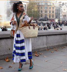 She's beautiful  Traditional Ethiopian/Eritrean dress.