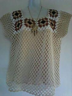 Blusa granny square anos 70.