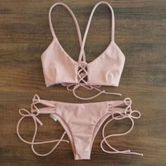 NEW CRISSCROSS SWIM SUIT TWO PIECE SET NEW CRISS CROSS STRAPPY BABY PINK 2 PIECE BIKINI BUNDLE  Comes brand new with out tags ! • Listing for size MED  ! • Set Available in size Small & medium. Comes in a salmon peach pink color. This Bundle includes 2 pieces : 1 criss crossed back lace up swim top & 1 cheeky Strappy bow tie swim bottoms ! Tags : acacia vs Victoria secret roxy acacia lulu for love of lemons beach wear swimwear ASKING 35+ 4 ship on de pop❤️( all items ship out of Cali with in…