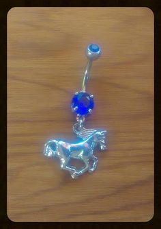 Hey cowgirls!! Heres the belly ring youve been looking for! :) This listing is for an awesome silver HORSE belly ring with a dark blue CZ