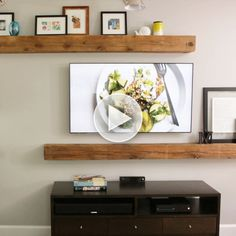 Wooden planks as shelves minus the tv console.