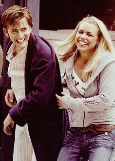 David Tennant and Billie Piper < I love how they were always smiling with each other while filming, that's why they worked so well on the show :)