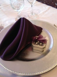 Silver beaded charger plates eggplant napkin