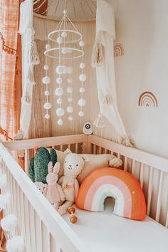 Baby Girl Nursery Room İdeas 54254370499555511 - Boho rainbow baby nursery closet in peach, brown, tan and neutrals Source by CallMePaname