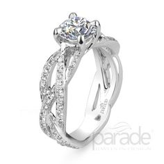 Parade Design Diamonds twists, turns and spirals up towards the center stone... loooooove this!