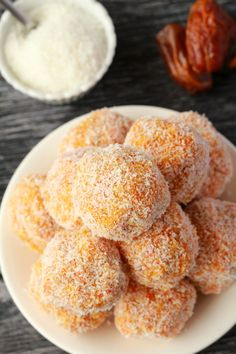 Perfectly bite-sized carrot cake balls. This easy 5-ingredient recipe is raw, vegan, gluten-free and makes a perfect snack or dessert.
