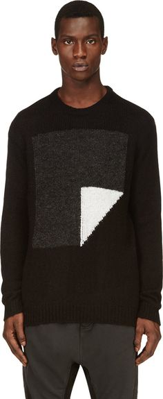 Long sleeve crewneck knit sweater in black, grey and white.  Boucle knit abstract pattern on front.  Ribbed cuffs, collar and hem. Tonal stitching.