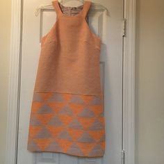 Trina Turk orange print dress. Size 2. Trina Turk orange print dress. Size 2. Only worn once and dry cleaned after. There is a built in lining with lace trim. Part of lace is slightly detached, not noticeable at all when wearing. Offers welcome. Trina Turk Dresses Mini