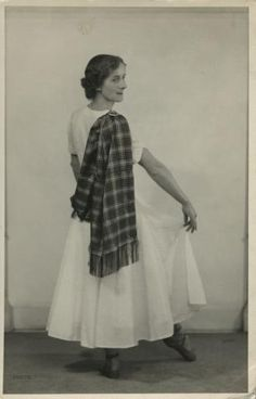 Photograph of Mina Corson demonstrating how to wear a sash - RSCDS AtoM